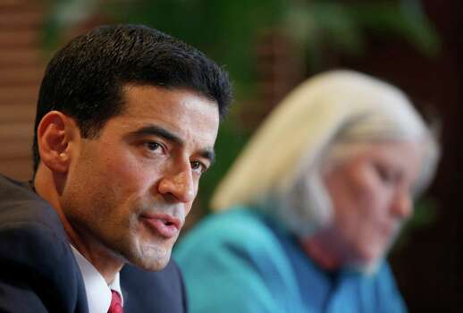 "Democratic District Attorney candidate Nicolas ""Nico"" LaHood talks Friday Jan. 17, 2014 to the San Antonio Express-News Editorial Board as follow democratic candidate Therese M. Huntzinger, right, listens. Photo: William Luther, San Antonio Express-News / @2014 San Antonio Express-News"