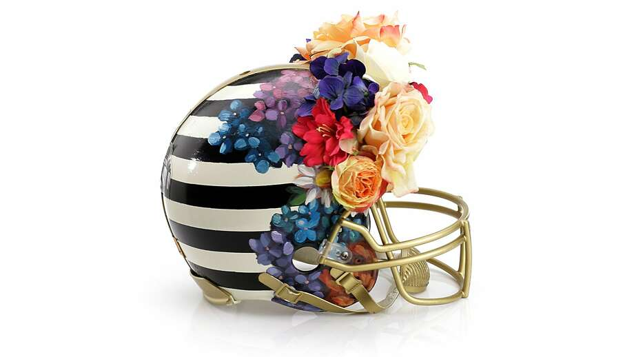 For the Super Bowl, Bloomingdale's, the NFL and the Council of Fashion Designers of America have collaborated on 48 one-of-a-kind football helmets. Photo: Cfda