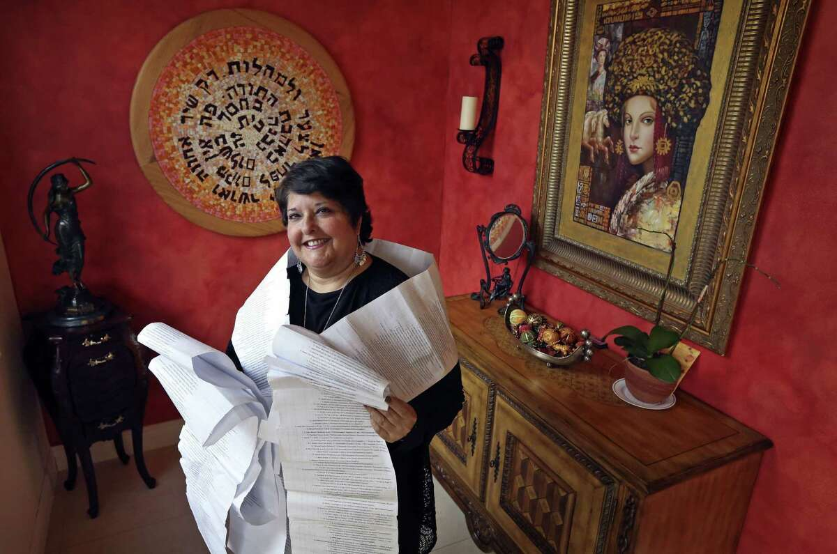 A paper filled with the names of 22 generations of her mother's maternal line envelopes Genie Milgrom.