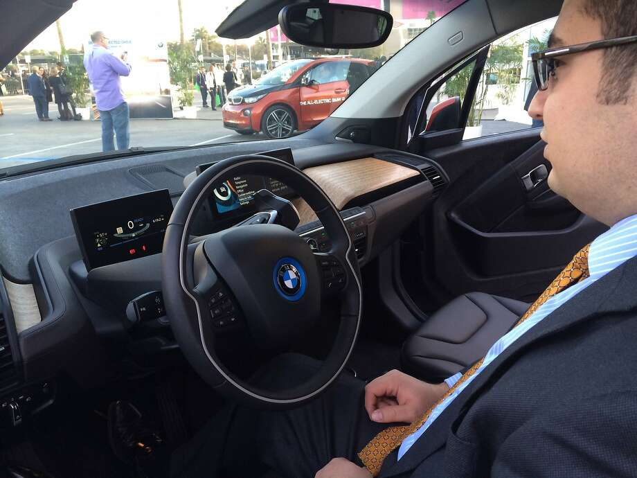 Jose Guerrero, BMW i product planning and strategy manager, shows off the technology inside an all-electric BMW i3, on display at the Consumer Electronics Show. Photo: Benny Evangelista