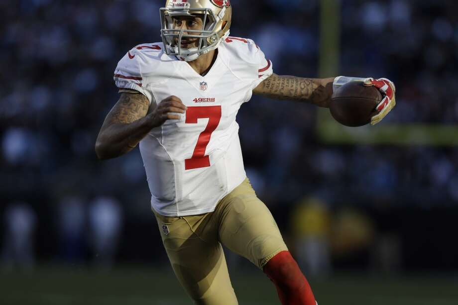 2. Will Colin Kaepernick exorcise his Emerald City demons?  …because the quarterbacks can help in that regard, too.  Perhaps no player has more to prove on Sunday than 49ers signal-caller Colin Kaepernick. A phenomenon since supplanting incumbent Alex Smith halfway through the 2012 season and leading San Francisco to a Super Bowl XLVII appearance, Kaepernick's strong arm and long strides have electrified stadiums throughout the NFL.  Well, most stadiums. Not in Seattle, though.  CenturyLink Field has been Kaepernick's house of horrors. In two starts, he is just 32-of-64 passing for 371 yards, 1 touchdown and 4 interceptions. He's been more successful on the ground, racking up 118 yards on 16 carries, but much of that came after the Niners went down big in Week 2 of this season.  Kaepernick's running ability may be the aspect of his game that gives the 49ers a chance to win. If he can establish a ground threat early in the game, that may prevent Carroll and defensive coordinator Dan Quinn from leaving Earl Thomas free to roam the back end of the Seahawks secondary. And if Thomas isn't playing deep to prevent big plays, it presents San Francisco receivers like Anquan Boldin and Vernon Davis with the opportunity to capitalize. Then again, the Hawks boast athletic pass-rushing lineman like Michael Bennett and Cliff Avril, as well as space-eaters like Brandon Mebane and Red Bryant, who have the ability to collapse the pocket and prevent Kaepernick from breaking free.  Regardless of how he gets the job done, Kaepernick needs to play better — or at least avoid a catastrophic mistake — for the 49ers to win. His rival on the other side doesn't necessarily face the same challenge. Photo: Gerry Broome, AP