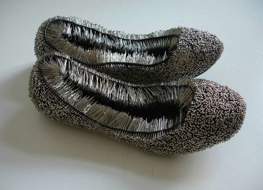 "Polish artist Erwina Ziomkowska's ""Untitled"" shoes with pins (2013) is featured in ""Pins & Needles"" through Feb. 20 at the Housatonic Museum of Art. Photo: Contributed Photo / Connecticut Post Contributed"