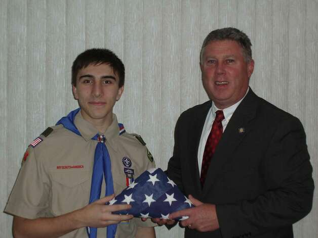 Andrew Scott Gariepy, 15, a sophomore at Cohoes High School, who earned an Eagle Scout award, is congratulated by Assemblyman John McDonald III. (Submitted photo)