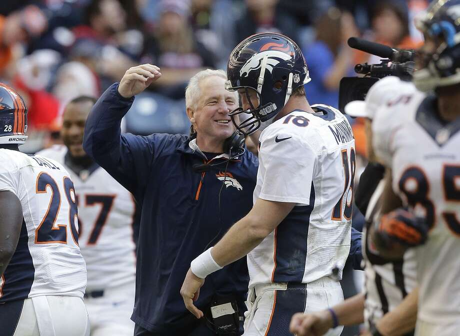 Broncos coach John Fox hopes Peyton Manning's Denver home success continues: 15-3 record and 54 TDs. Photo: Patric Schneider, Associated Press