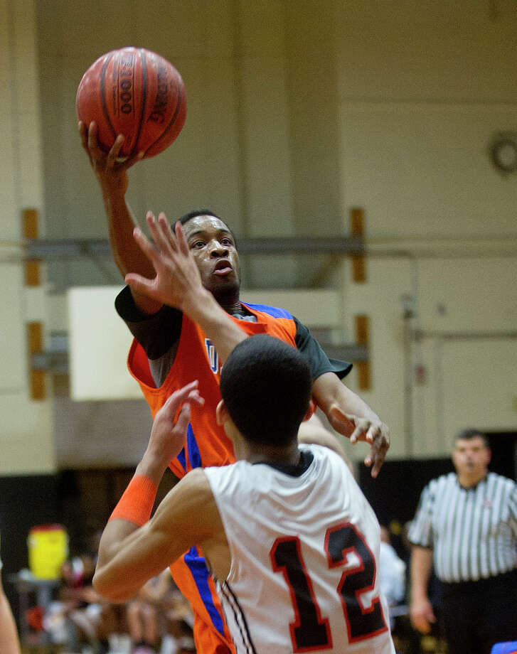 Danbury's Chris Latham takes a shot during Friday's basketball game at Stamford High School on January 17, 2014. Photo: Lindsay Perry / Stamford Advocate