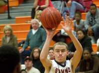Stamford's Jay Devito takes a shot during Friday's basketball game at Stamford High School on January 17, 2014.