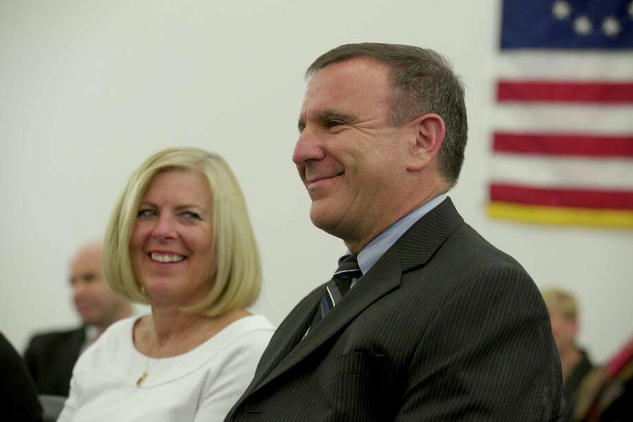 Southington Schools Superintendent Joseph Erardi Jr. smiles as Newtown Connecticut Board of Education members speak about him after voting to hire Eradi as Newtown Superintendent of Schools on Friday night,  January 17, 2014. Sue Erardi, his wife,  looks on. Photo: H John Voorhees III / The News-Times Freelance