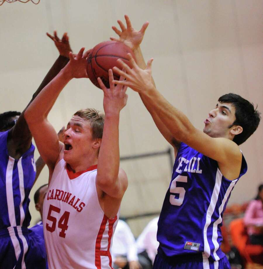 Alex Wolf of Greenwich (# 54) goes for a rebound along with Evan Skoparantzos (#5) of Westhill, at right, during the boys high school basketball game between Greenwich High School and Westhill High School at Greenwich, Friday night, Jan. 17, 2014. Photo: Bob Luckey / Greenwich Time