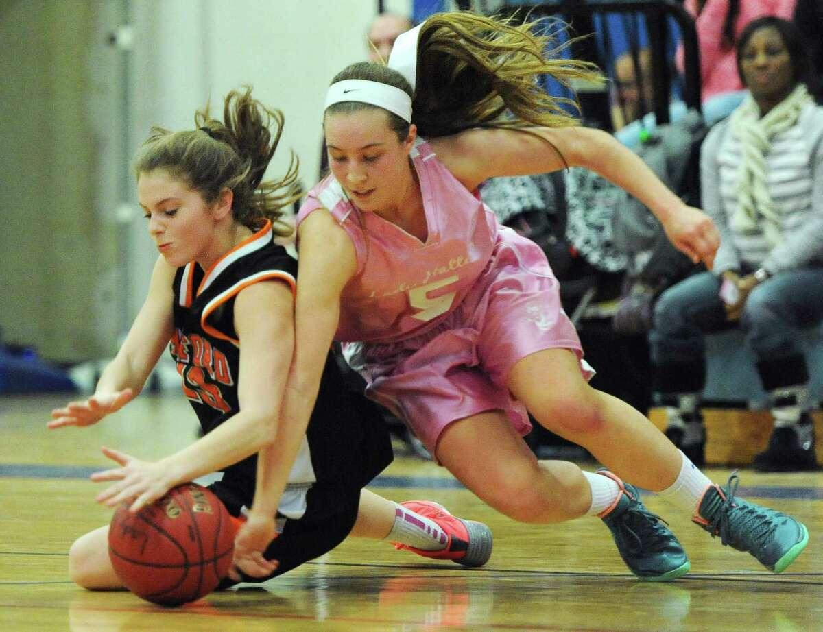 Stamford's Maxine Fodiman, left, and Danbury's Rachel Gartner dive for a loose ball in Danbury's 40-27 win over Stamford in the girls high school basketball game at Danbury High School in Danbury, Conn. on Friday, Jan. 17, 2014.