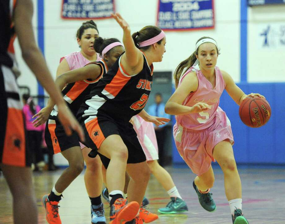 Photos from Danbury's 40-27 win over Stamford in the girls high school basketball game at Danbury High School in Danbury, Conn. on Friday, Jan. 17, 2014. Photo: Tyler Sizemore / The News-Times