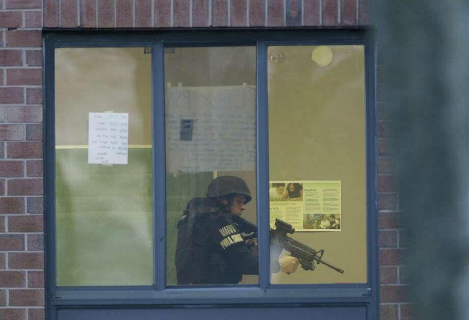 Police search at the Delaware Valley Charter School in Philadelphia. Police were unclear if the shooting was accidental or intentional, the police commissioner said. Photo: Mark Rourke / Associated Press / AP