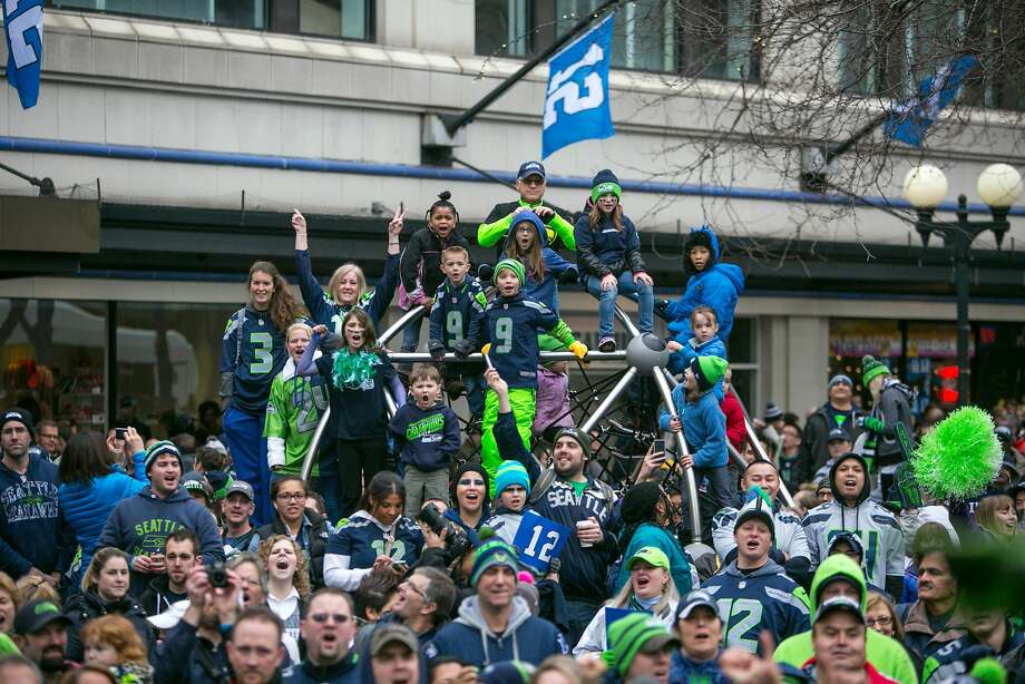 Seattle Seahawks fans participate in a rally for the NFL football team at Westlake Park on Friday, Jan. 17, 2014, in Seattle. The Seahawks play the San Francisco 49ers on Sunday for the NFC championship.(AP Photo/seattlepi.com, Joshua Trujillo)  MAGS OUT; NO SALES; SEATTLE TIMES OUT; TV OUT; MANDATORY CREDIT Photo: Joshua Trujillo, Associated Press