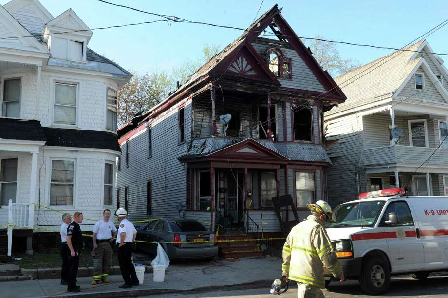 Fire investigators work the scene of a fatal fire at 438 Hulett Street on Thursday, May 2, 2013, in Schenectady, N.Y. (Michael P. Farrell/Times Union archive) Photo: Michael P. Farrell / 10022261A