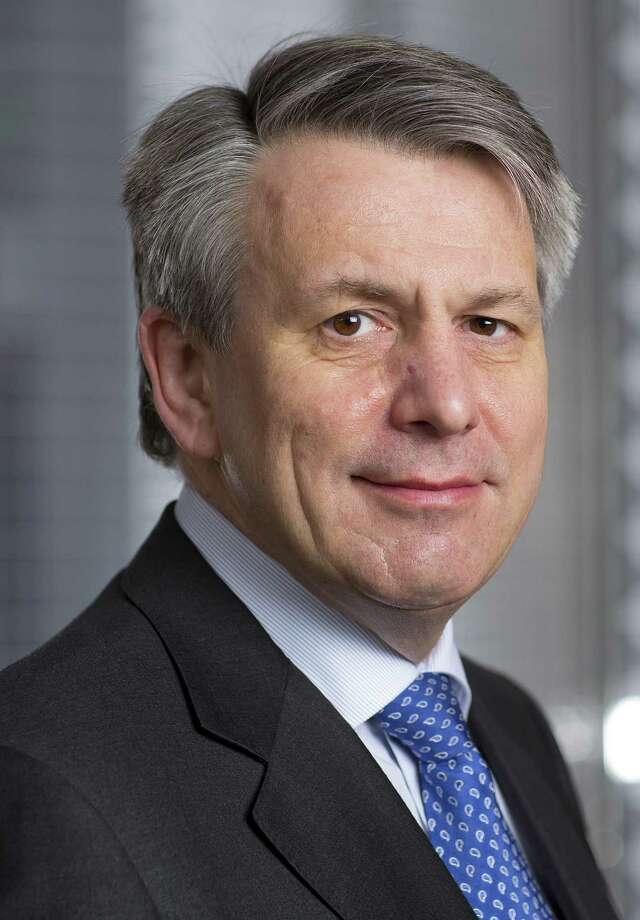 """This undated handout picture received from Royal Dutch Shell plc on July 9, 2013 shows the companys' newly appointed chief executive Ben van Beurden posing for a photograph. Shell issued a severe profits warning on January 17, 2014 blaming exploration costs, pressures across the oil industry and disruption to Nigerian output, and its shares fell sharply. """"Our 2013 performance was not what I expect from Shell,"""" said chief executive Ben van Beurden in the gloomy update, published just two weeks after he took the helm at the Anglo-Dutch energy major. RESTRICTED TO EDITORIAL USE - MANDATORY CREDIT  """" AFP PHOTO/ROYAL DUTCH SHELL/REINIER GERRITSEN """"  -  NO MARKETING NO ADVERTISING CAMPAIGNS   -   DISTRIBUTED AS A SERVICE TO CLIENTSREINIER GERRITSEN/AFP/Getty Images Photo: REINIER GERRITSEN, Handout / AFP ImageForum"""