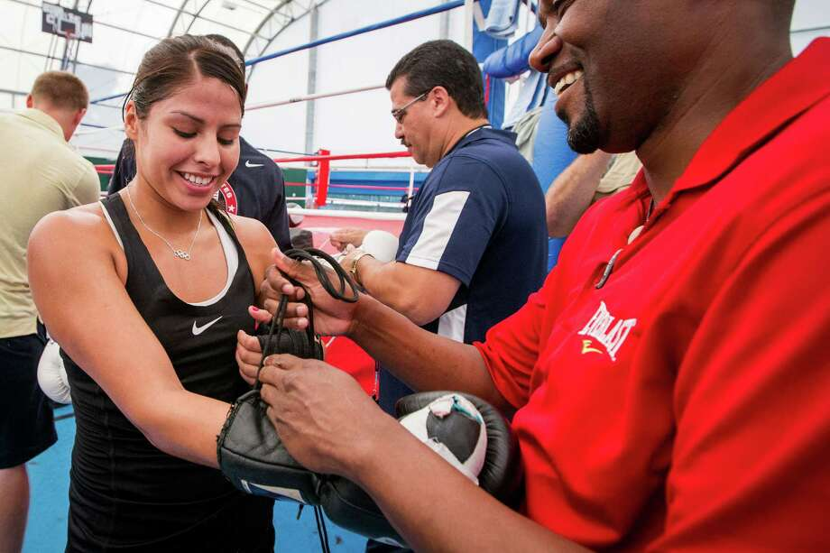 Marlen Esparza, left, will try to become a nine-time champion when she competes in the USA Boxing Championships at Spokane, Wash., on Jan. 18-25. Photo: Smiley N. Pool, Staff / © 2012  Houston Chronicle