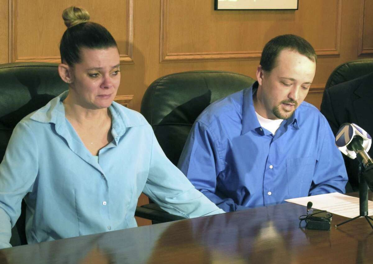 Missie McGuire cries as her husband, Dennis McGuire, talks about the execution of his father. The executed killer's children plan to sue Ohio over the lethal injection.