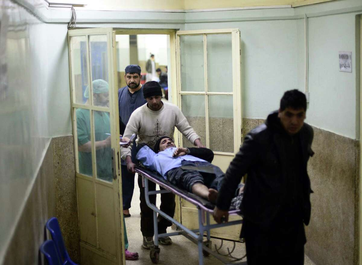 Cook Abdul Majid is brought into a hospital after the suicide bombing in a Kabul restaurant. He suffered broken bones as he escaped. The attack killed 16 people, four of them U.N. personnel.