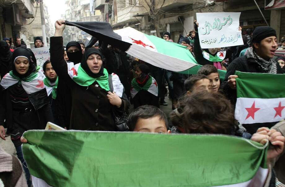 Syrian protesters in Aleppo shout during a demonstration calling for an end on the siege of Yarmouk Palestinian refugee camp in southern Damascus. Photo: Mohammed Al-Khatieb / Getty Images / AFP