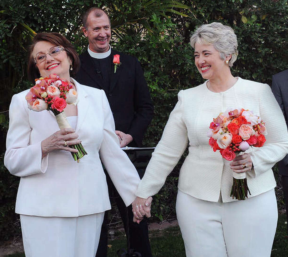 Houston Mayor Annise Parker (right) and her longtime partner, Kathy Hubbard, celebrate at their wedding in Palm Springs, Calif.