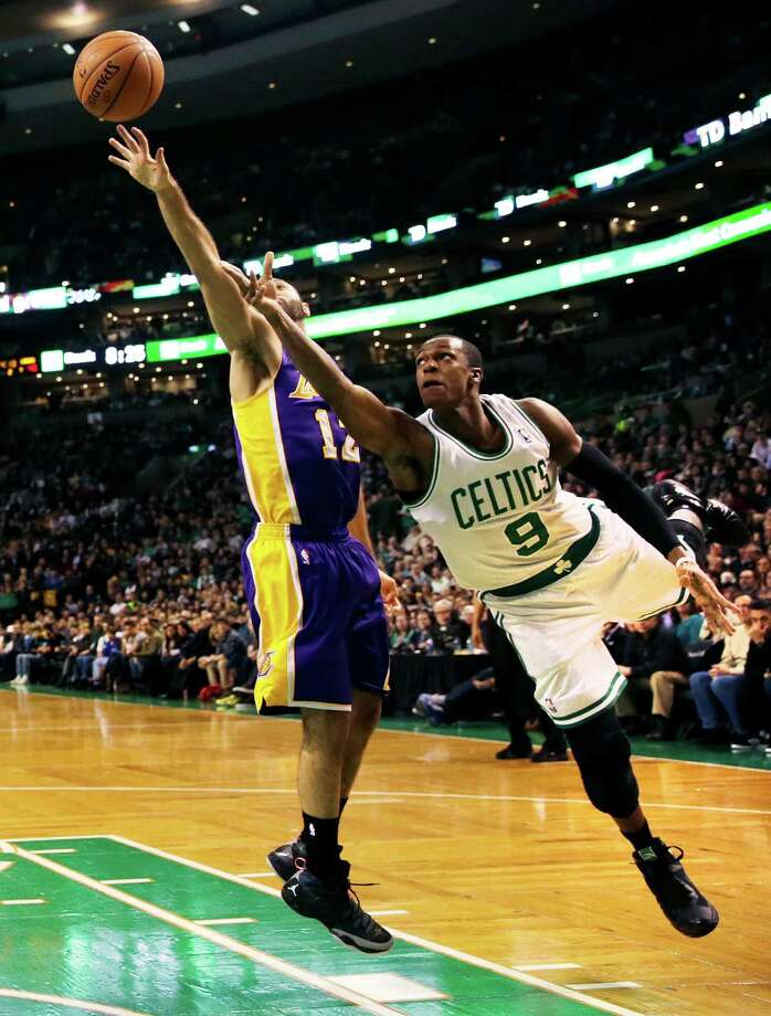 Boston Celtics guard Rajon Rondo (9) follows through on a shot after driving past Los Angeles Lakers guard Kendall Marshall, left, during the second quarter of an NBA basketball game in Boston, Friday, Jan. 17, 2014. Rondo returned to the court for the first time this season, after undergoing surgery on his right knee. (AP Photo/Charles Krupa) ORG XMIT: MACK108 Photo: Charles Krupa / AP