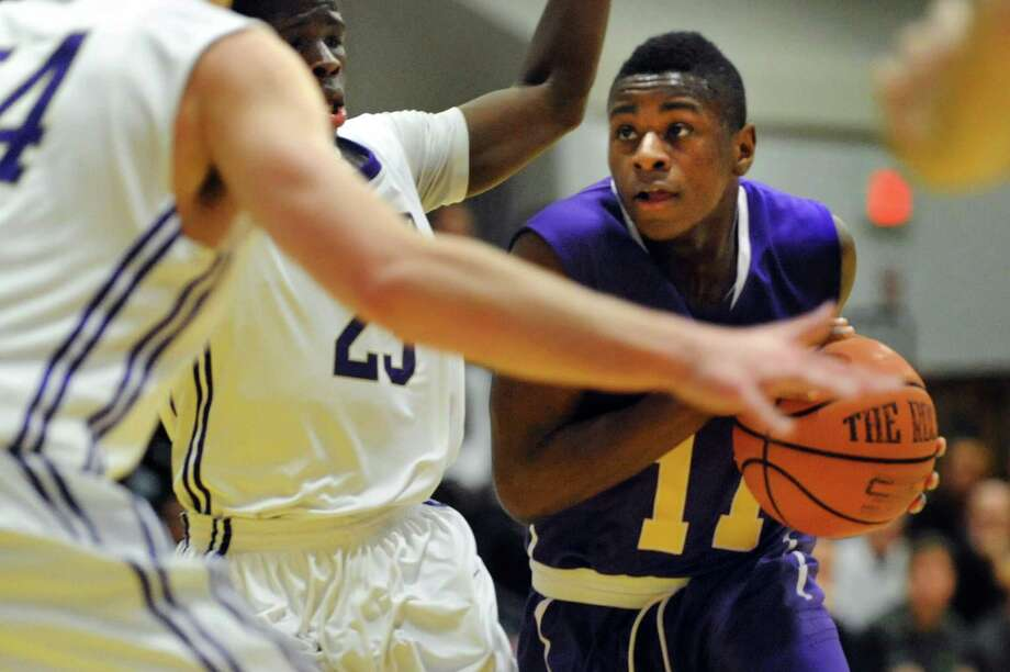 Troy's Dyaire Holt, right, fights his way to the hoop during their basketball game against CBA on Friday, Jan. 17, 2014, at Christian Brothers Academy in Colonie, N.Y. (Cindy Schultz / Times Union) Photo: Cindy Schultz / 00025389A