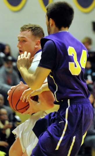 CBA's  Nick Marini, left, controls the ball as Troy's Connor Nicoll defends during their basketball