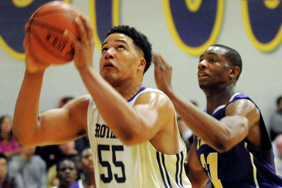 CBA's  Brian Renauld, left, looks to the hoop as Troy's Justice Walston defends during their basketball game on Friday, Jan. 17, 2014, at Christian Brothers Academy in Colonie, N.Y. (Cindy Schultz / Times Union) Photo: Cindy Schultz / 00025389A