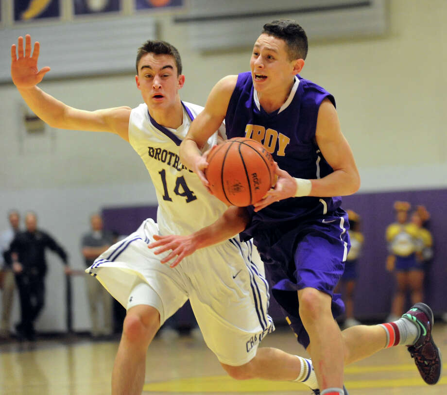 Troy's Zach Radz, right, drives up court as CBA's Jacob Foglia defends during their basketball game on Friday, Jan. 17, 2014, at Christian Brothers Academy in Colonie, N.Y. (Cindy Schultz / Times Union) Photo: Cindy Schultz / 00025389A