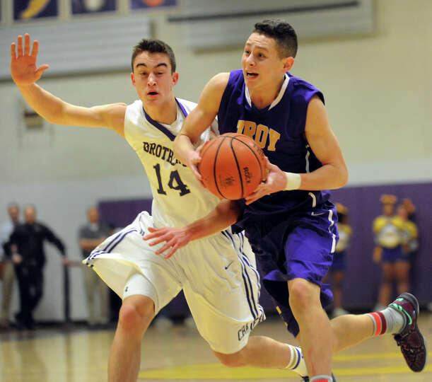 Troy's Zach Radz, right, drives up court as CBA's Jacob Foglia defends during their basketball game