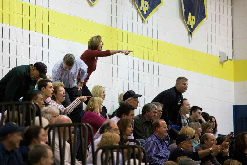 Fans react to a foul called during the Averill Park girls' basketball game against Shenendehowa, Fri