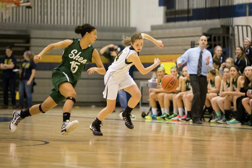 Averill Park's #4 Jenna Miner and Shen's #15 Sydney Quinn chase down a loose ball during the girls'