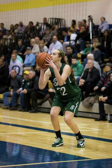 Shen's #32 Carly Boland poises for a three point shot during the girls' basketball game against Aver