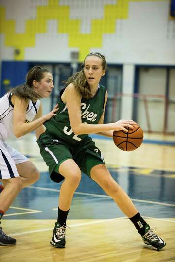 Shen's #32 Carly Boland looks for an open pass during the girls' basketball game against Averill Par