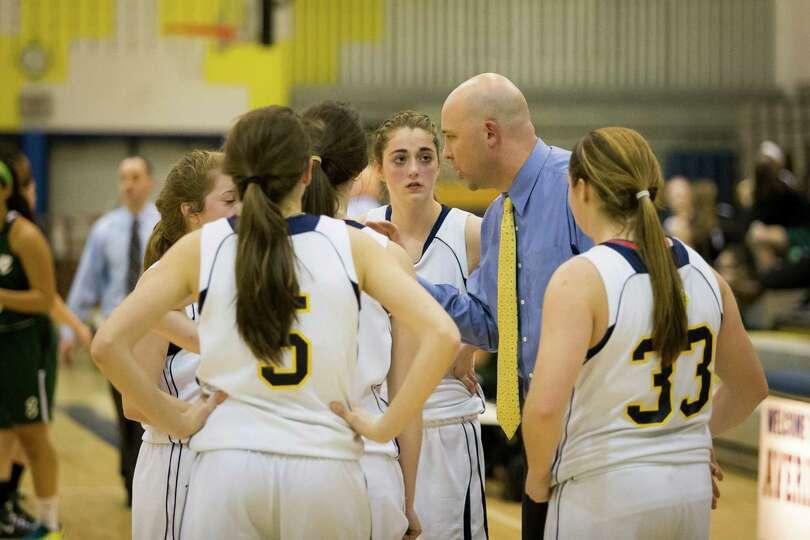 Averill Park head coach Sean Organ talks to his team during their girls' basketball game against She