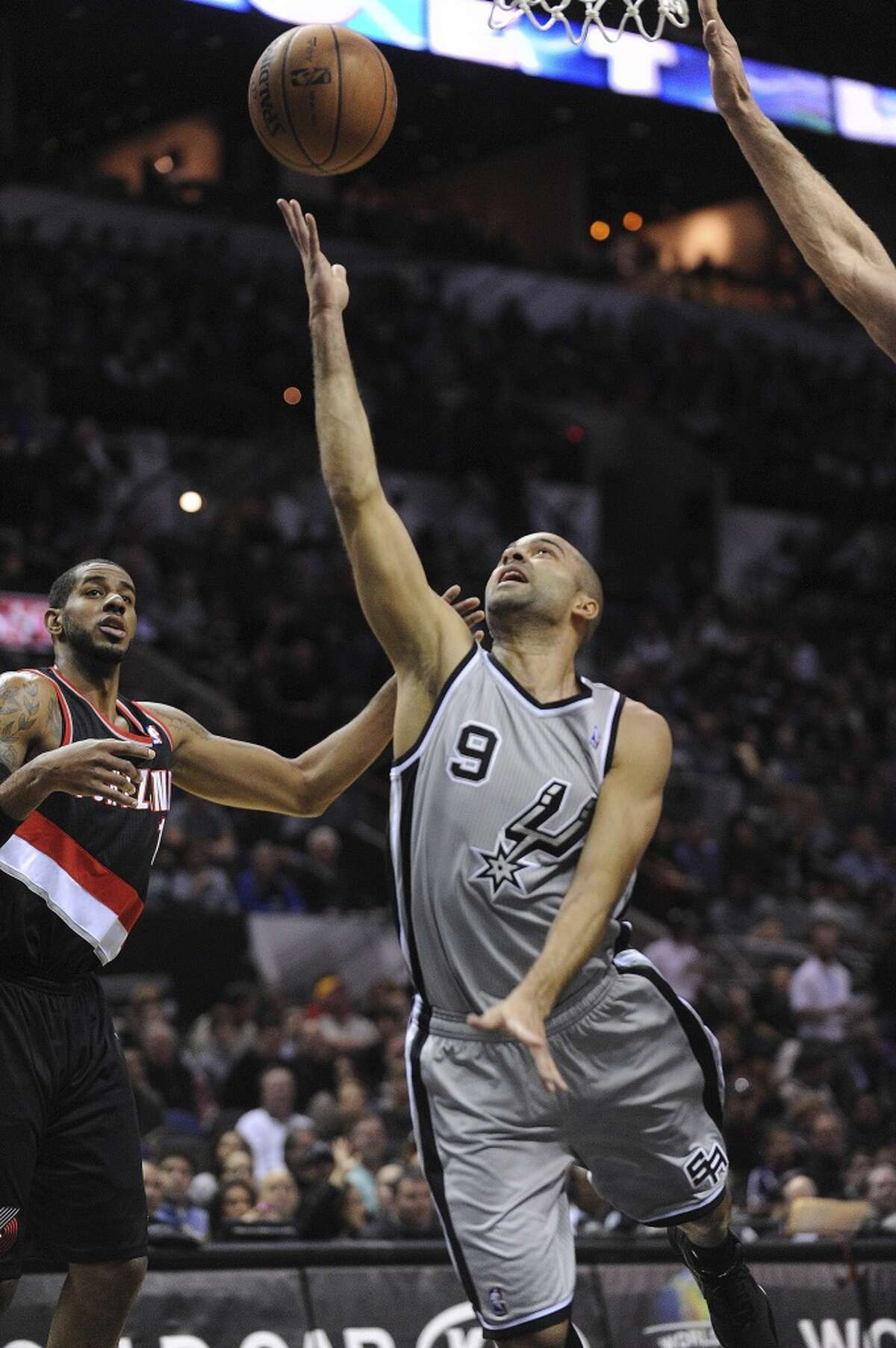 Tony Parker (9) of the San Antonio Spurs lays up the ball during NBA action against the Portland Trailblazers in the AT&T Center on Friday, Jan. 17, 2014.