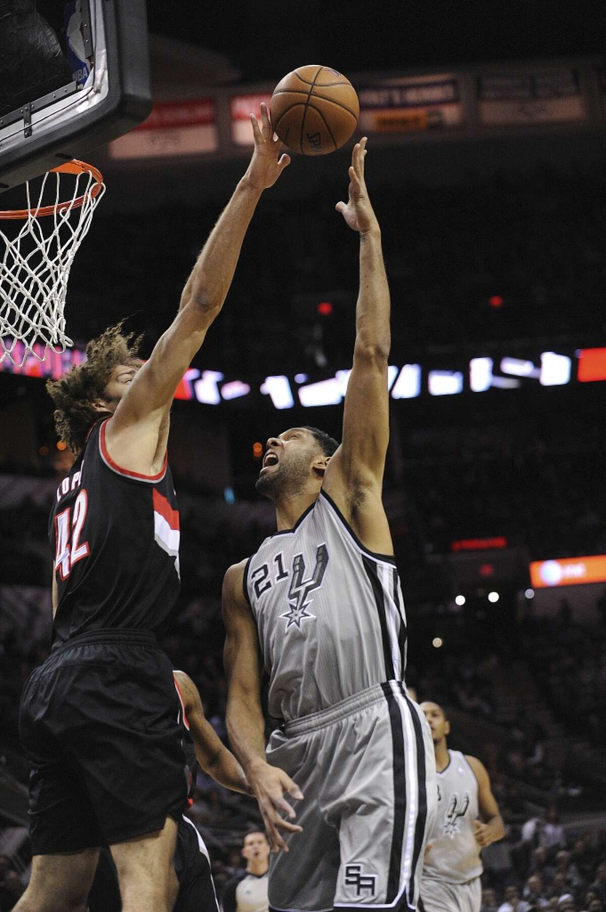 Tim Duncan (21) of the San Antonio Spurs has a shot blocked by Robin Lopez (42) of the Portland Trailblazers during NBA action in the AT&T Center on Friday, Jan. 17, 2014.