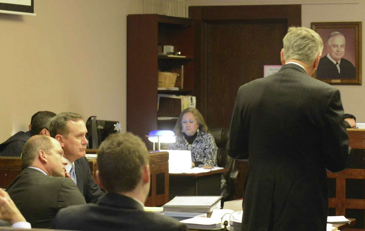 Prosecutors allege Mike McCrum (second from left) told a witness to turn off her phone because she was not under subpoena. He also suggested the DA