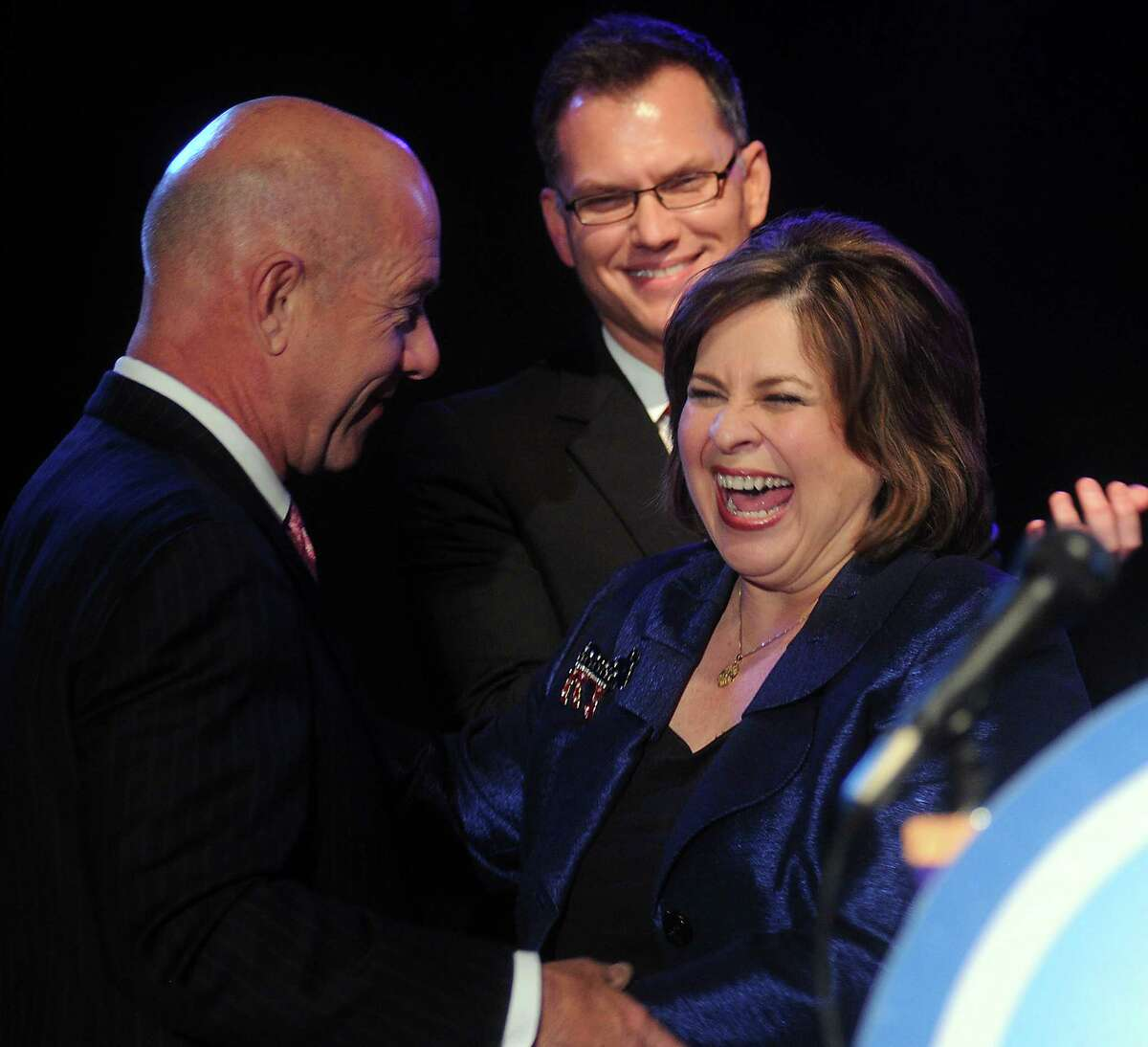 State senator John Whitmire welcomes lieutenant governor candidate Leticia Van de Putte at the 2nd Annual Toast to a Blue Year Celebration at Warehouse Live Thursday Jan 16 2014.(Dave Rossman photo)