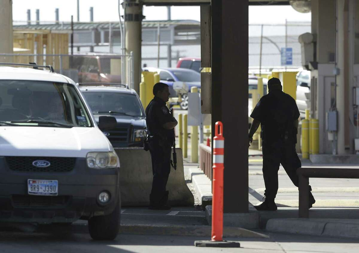 Customs and Border Patrol officers work the traffic on the Gateway International Bridge in downtown Brownsville on Friday.