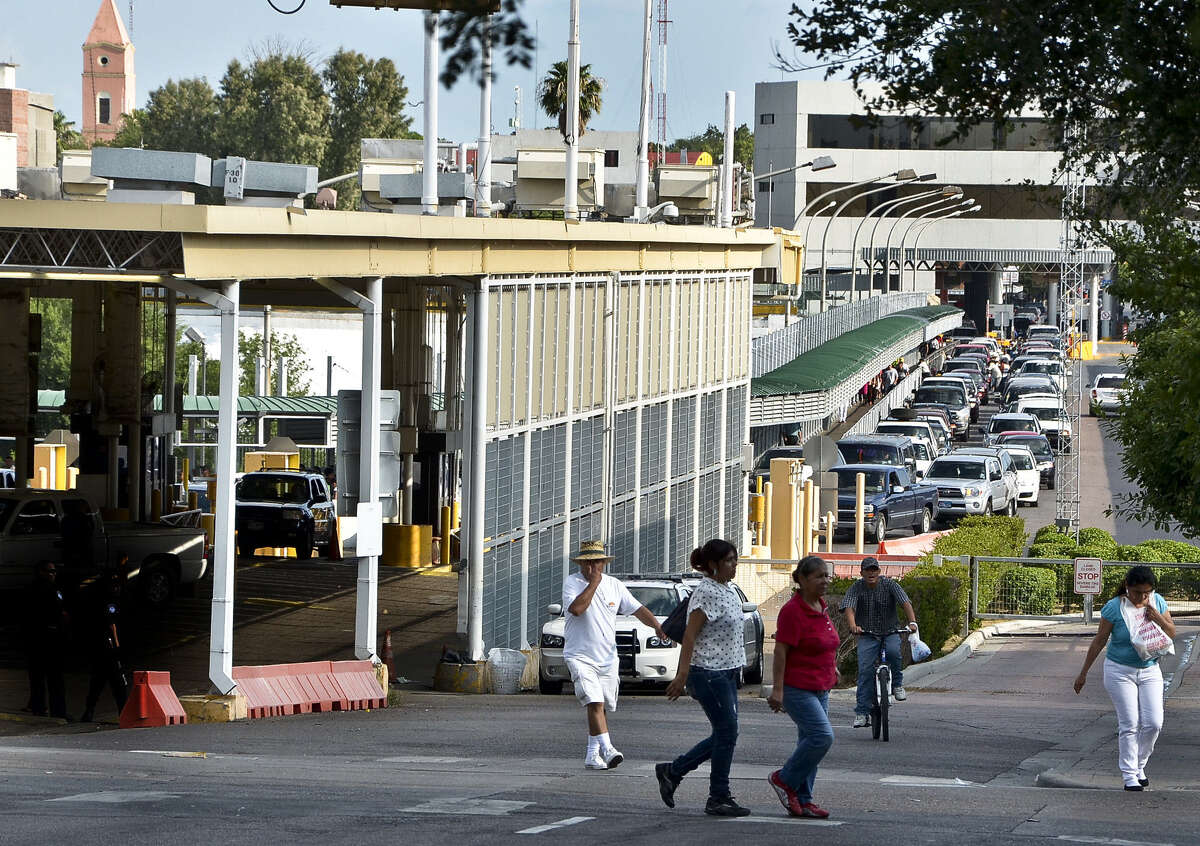 Pedestrians make their way from the Gateway to the Americas International Bridge as motorists cross into the United States from Mexico.