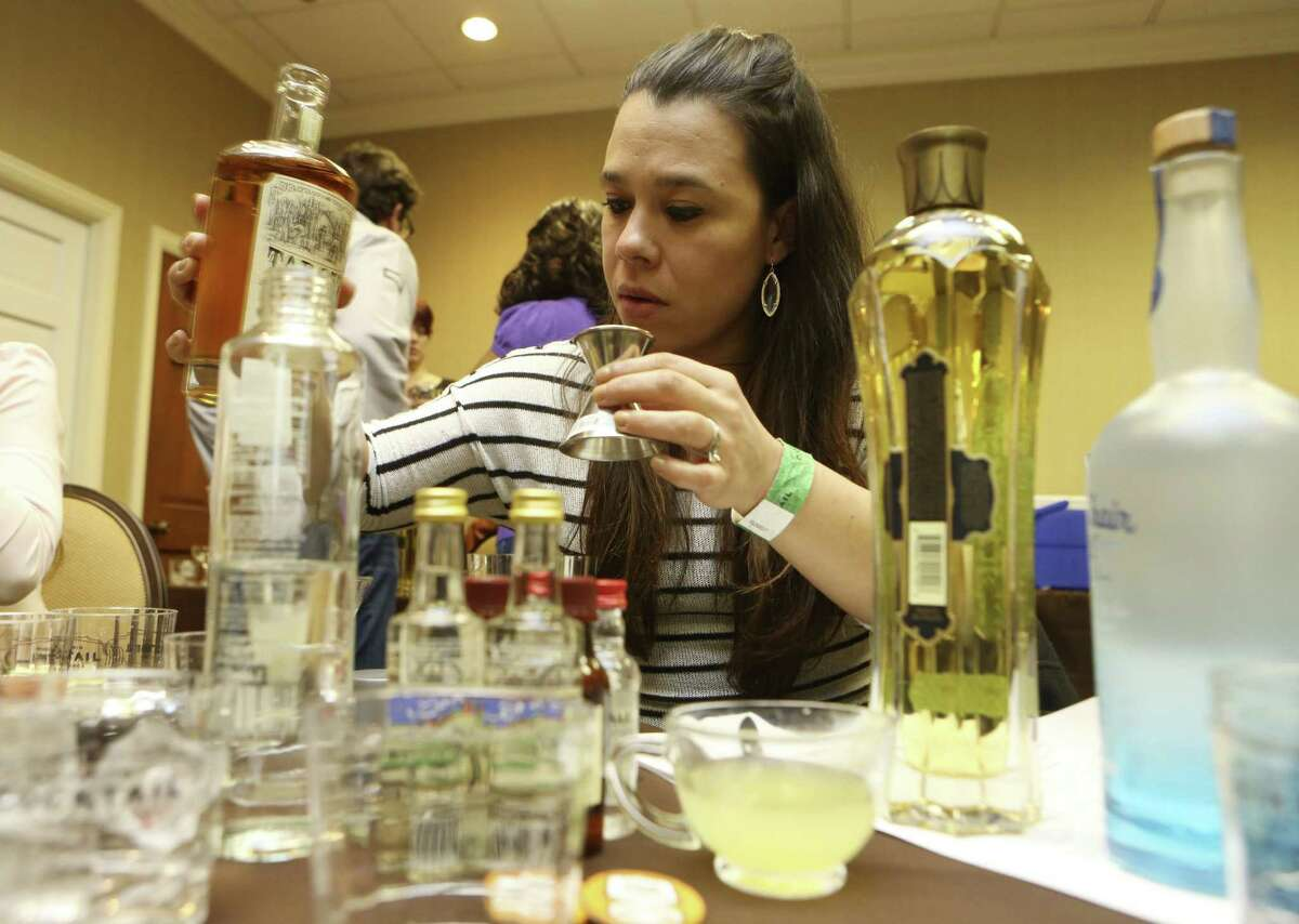 Sara Calderon experiments with flavors at the Build Your Own Signature Cocktail seminar Friday.