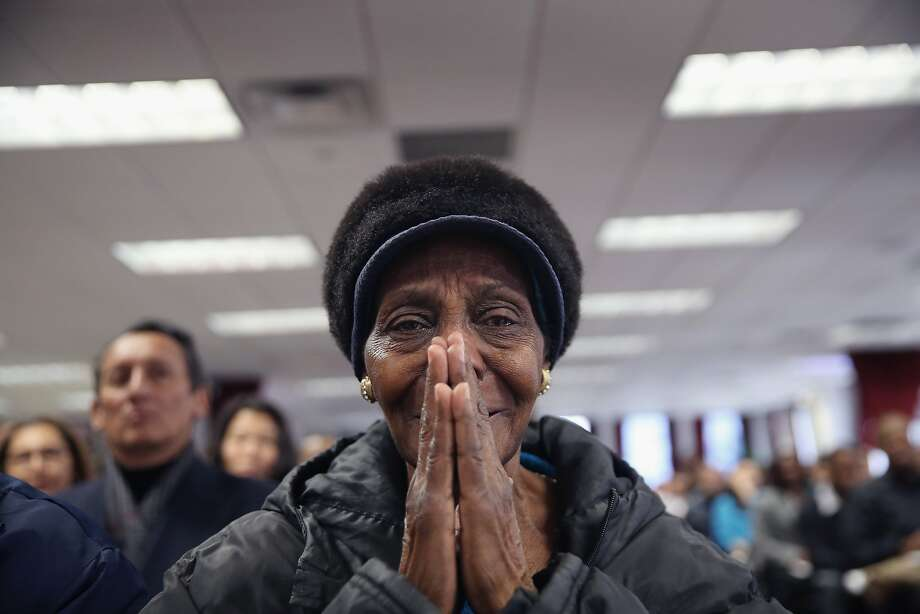 NEW YORK, NY - JANUARY 17:  Dominican immigrant Santa Hernandez de la Cruz, 76, sheds tears of joy after taking the oath of allegiance to the United States at a naturalization ceremony on January 17, 2014 in New York City. One hundred and fifty-three people from 41 countries became American citizens at the event.  (Photo by John Moore/Getty Images) *** BESTPIX *** Photo: John Moore, Getty Images