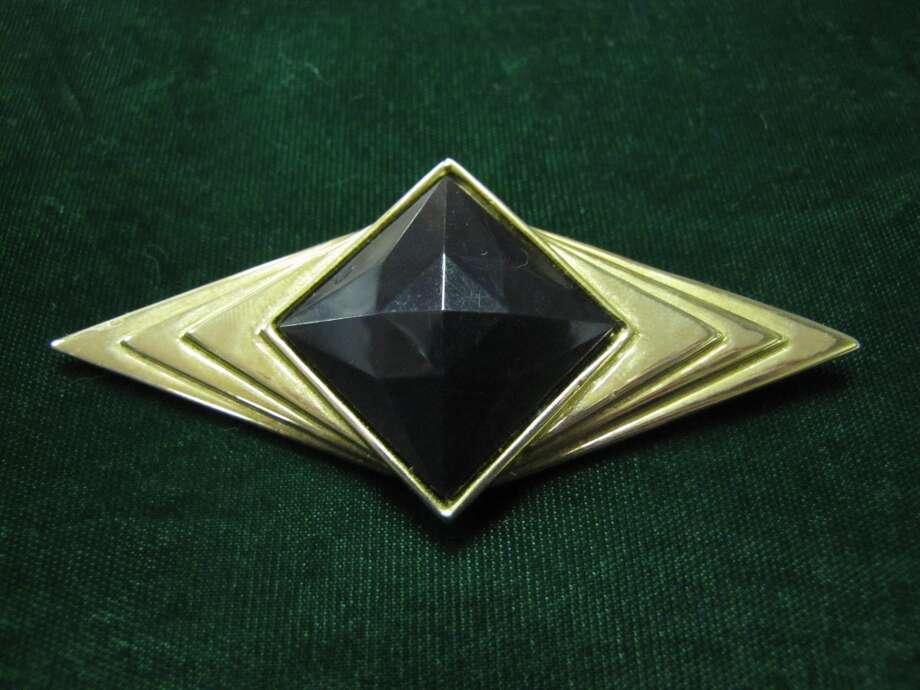 Vintage brooch, $5. BAW Resale and Interiors, Beaumont Photo: Cat5