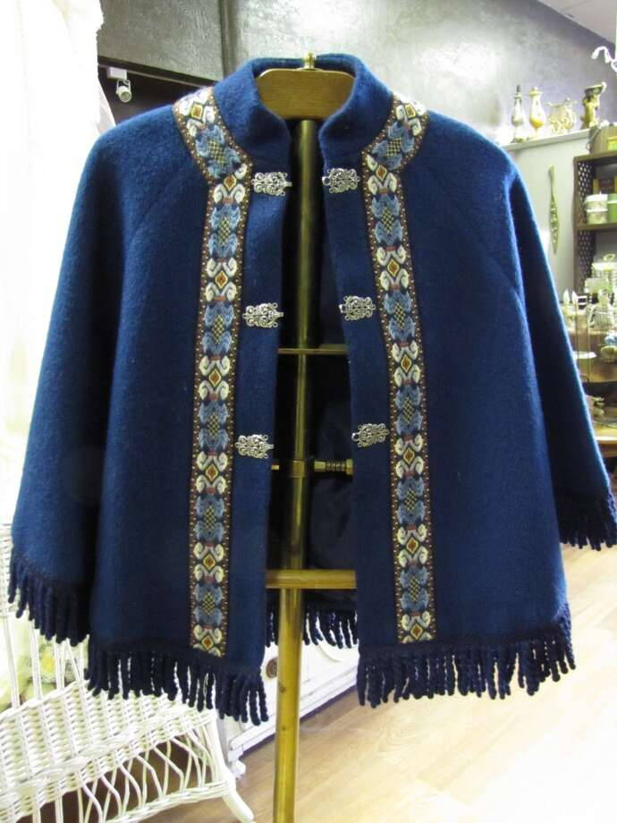 Wool poncho, $25; brass valet, $50. BAW Resale and Interiors, Beaumont Photo: Cat5