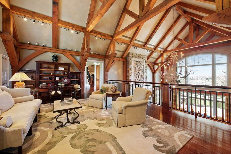 The interior of a home in Ridgefield, which is part of an 87-acre estate that hit the market for $55 million Friday. Photo Courtesy of Douglas Elliman Real Estate. Photo: RICHARD CAPLAN, Copyright Richard Photography 2013 / Copyright Richard Photography 2013