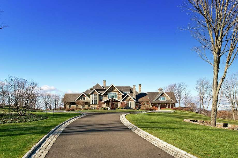 The exterior of a home in Ridgefield, which is part of an 87-acre estate that hit the market for $55 million Friday.  Photo Courtesy of Douglas Elliman Real Estate. Photo: RICHARD CAPLAN, Copyright Richard Photography 2013 / Copyright Richard Photography 2013
