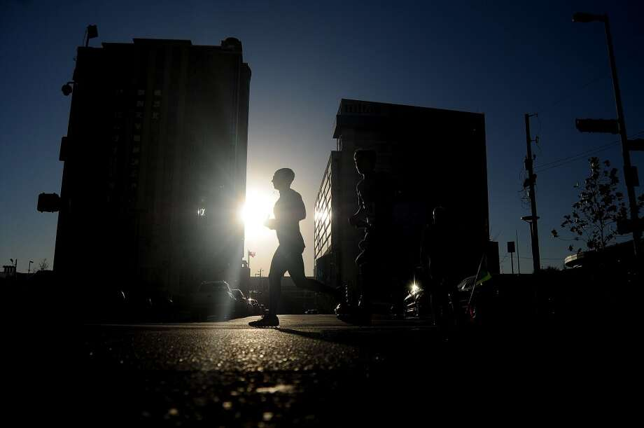 Runners head up Austin Street during the ABB 5K race. Photo: Dave Rossman, For The Chronicle