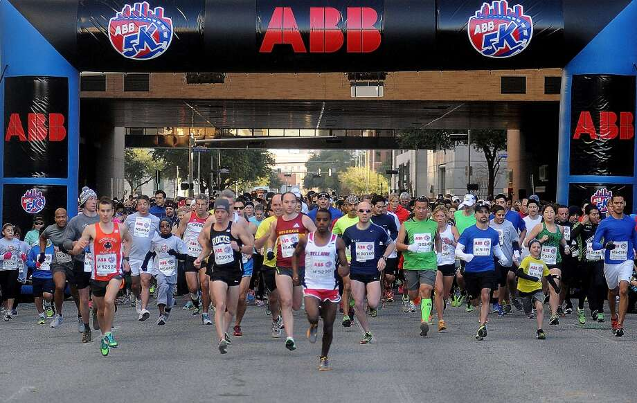 Runners start the ABB 5K race downtown. Photo: Dave Rossman, For The Chronicle