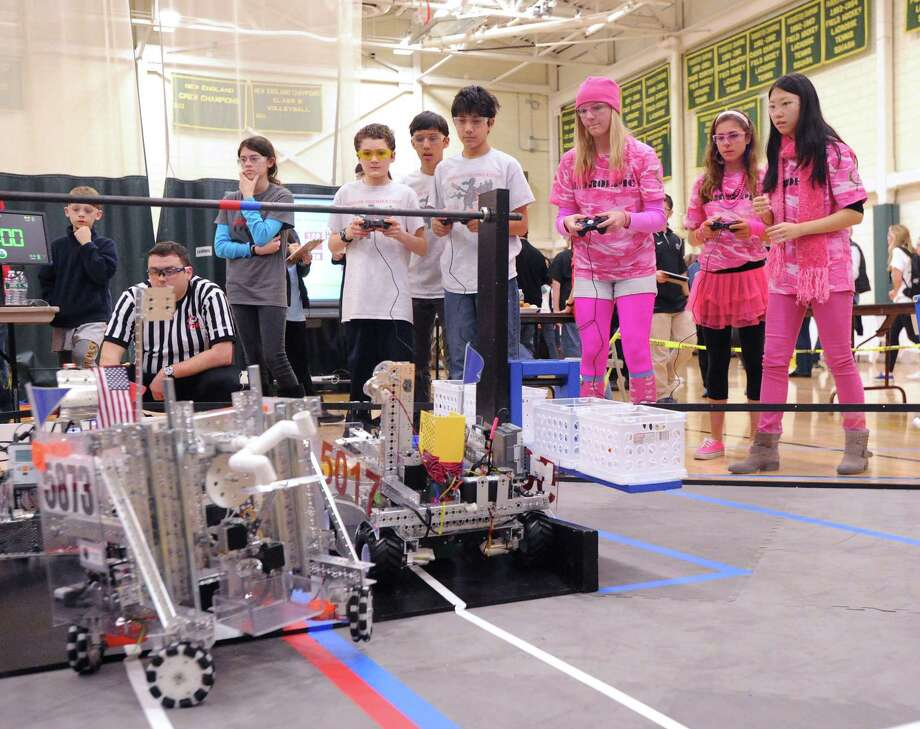 "Greenwich Academy robotics team members, Erika Kraus (wearing hat at center), 15, Maxx Grossman (second from right), 17, and Yuge Ji, 17, right, control their team's robot named ""Tiger Lily""  during the FIRST Tech Challenge high school robotics competition at Greenwich Academy, Saturday, Jan. 18, 2014. Twenty-two teams participated in the qualifier. The FTC Connecticut Robotics Championship is scheduled for Saturday, March 8, at Greens Farms Academy in Westport. Photo: Bob Luckey / Greenwich Time"