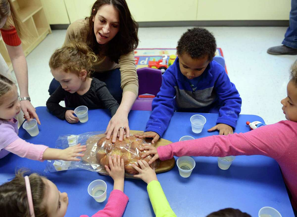 Rachael Levitt, of Trumbull, leads the blessing over the bread during the Young Families Havurah at Congregation B'nai Israel in Bridgeport Saturday, Jan. 18, 2013. The Shabbat morning community meets every Saturday morning at B'nai Israel for music, arts, fun, and more starting around 9:30 for bagels and then at 9:45 for Shabbat singing and service. All families with children 5 years and younger are welcome to attend.